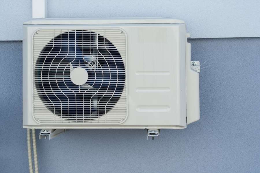 Air conditioning unit hooked up outside a beautiful house in Marble Falls, Texas.