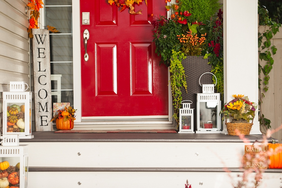 Home entrance adorned with fall decor. 5 reasons for a fall furnace clean and check.