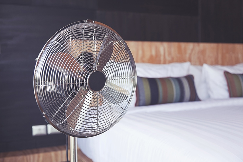 old electric fan near the bed in the room, improve your home's indoor air quality