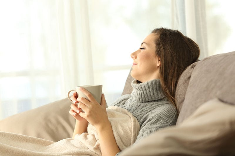 Happy Woman on Couch