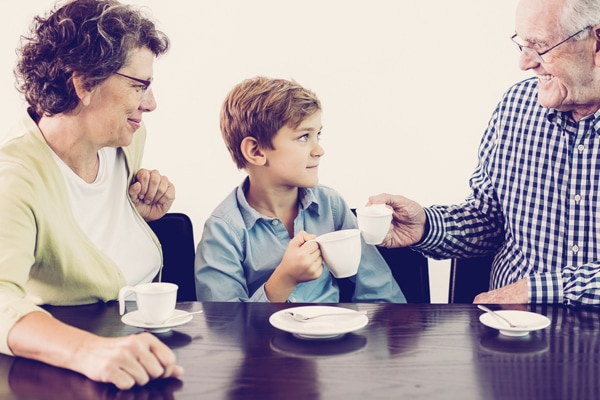 Grandson and Grandparents Drinking Hot Chocolate, schedule your annual furnace inspection
